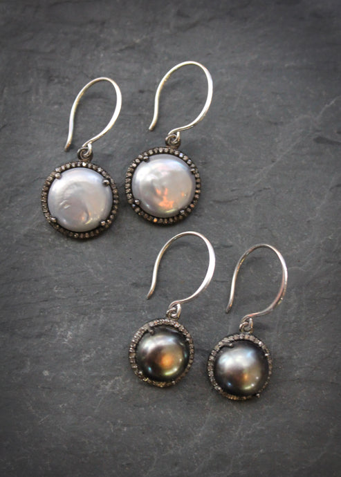 Sea and Stone Jewelry - Drop earrings with pearls set in oxidized silver and embellished with a diamond surround, hung on silver hook ear wires. Silver white pearl and black pearl shown.