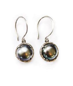 Sea and Stone Jewelry - Drop earrings with pearls set in oxidized silver and embellished with a diamond surround, hung on silver hook ear wires. Black pearl shown.
