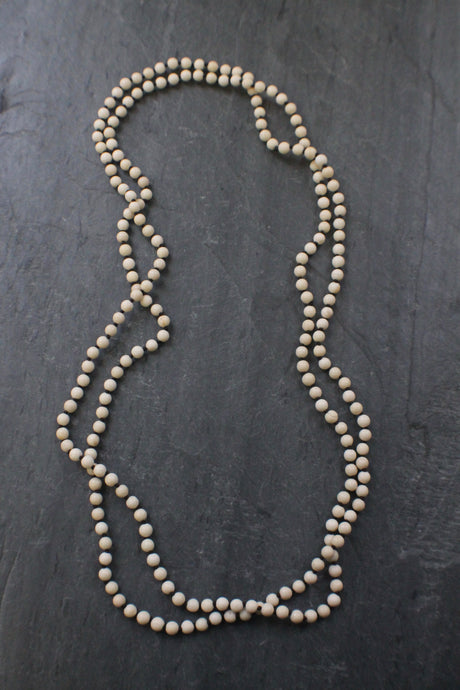 Sea and Stone Jewelry - An extra long hand knotted necklace of river stone beads. No clasp.