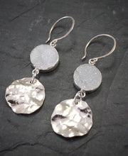 Sea and Stone Jewelry - Drop earrings featuring shining druzy and hammered silver circlets under sterling silver hook ear wires. Side view.