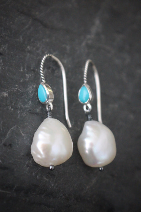 Sea and Stone Jewelry - Drop earrings featuring pearls under twisted sterling silver ear wires set with pear shaped turquoise stones. December birthstone.