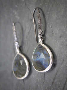 Sea and Stone Jewelry - Drop earrings featuring labradorite droplets set into silver under blackened silver hook ear wires set with pave white topaz.