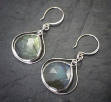 Sea and Stone Jewelry - Drop earrings featuring labradorite droplets set into silver with a second silver wire framing its shape, under silver hook ear wires. side view.