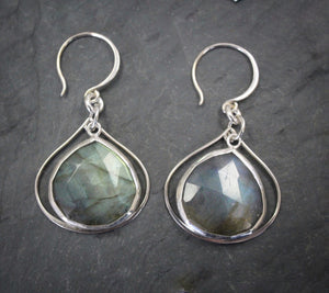 Sea and Stone Jewelry - Drop earrings featuring labradorite droplets set into silver with a second silver wire framing its shape, under silver hook ear wires.