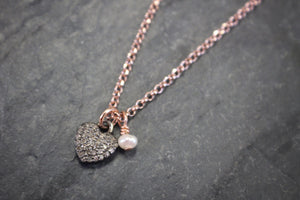Sea and Stone Jewelry - A heart pendant set with pave diamonds and embellished with a dainty white pearl hangs from a delicate gold vermeil chain necklace.