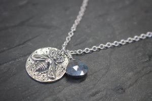 Sea and Stone Jewelry - A silver stamped bee pendant, embellished with a hand wrapped sapphire briolette, hangs from a sterling silver chain.