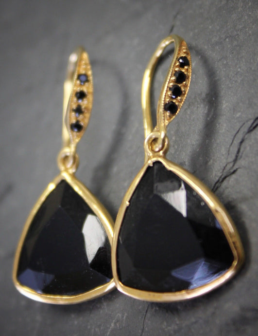 Sea and Stone Jewelry - Drop earrings featuring trillion cut onyx stones set in and hanging under gold vermeil hook ear wires accented with tiny black spinel gemstones.