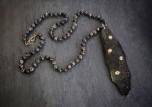 sea and stone fossil horn and diamond necklace