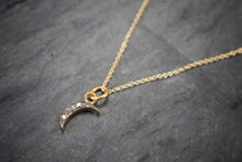 Sea and Stone Jewelry - A thin crescent moon pendant set with pave diamonds hangs from a delicate gold vermeil chain necklace.