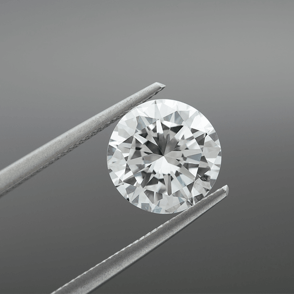 Lab grown diamond in tweezers