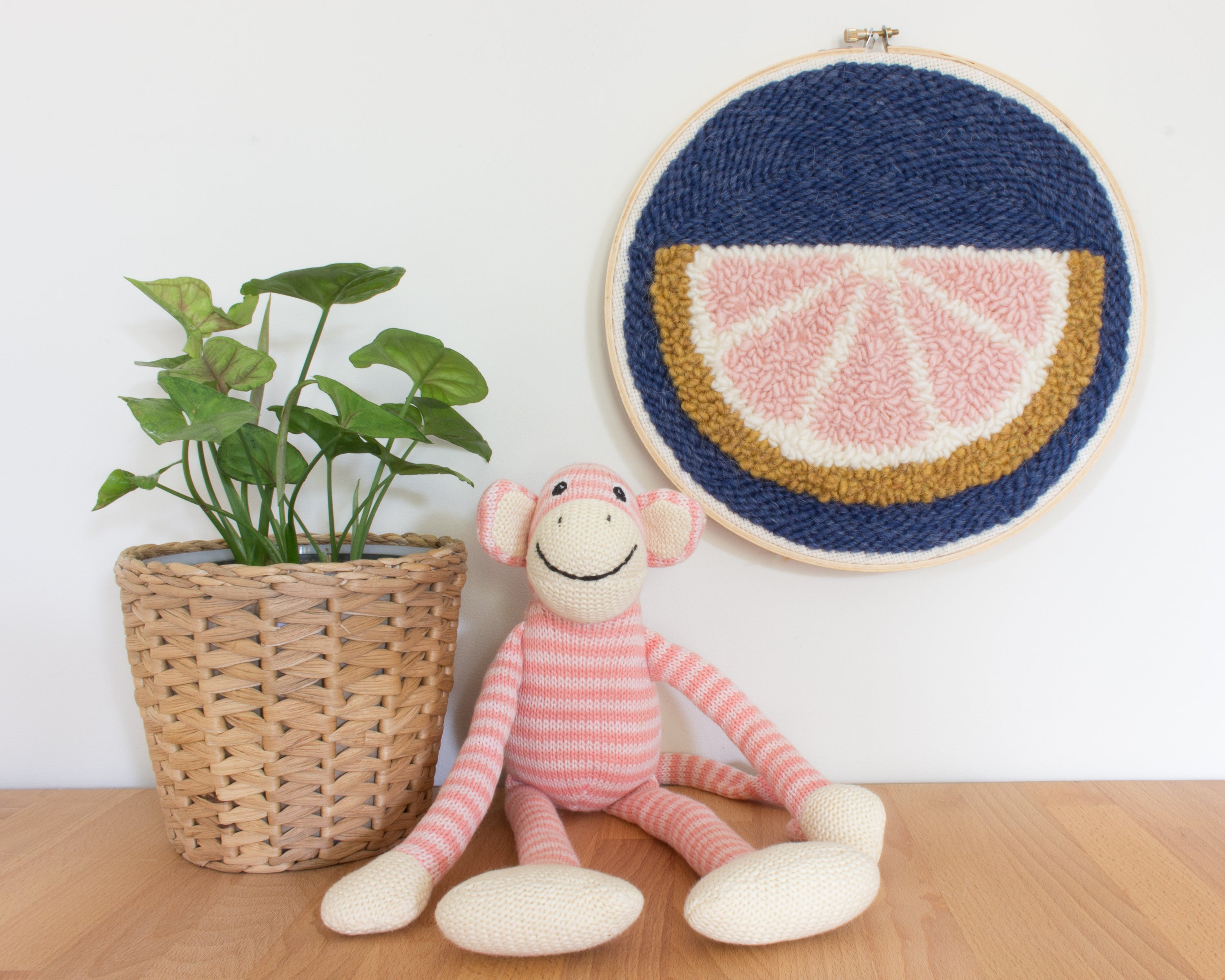 Grapefruit punch needle wall hanging