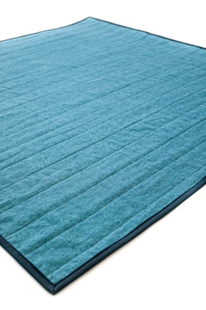 emerald squares quilt with blue backing