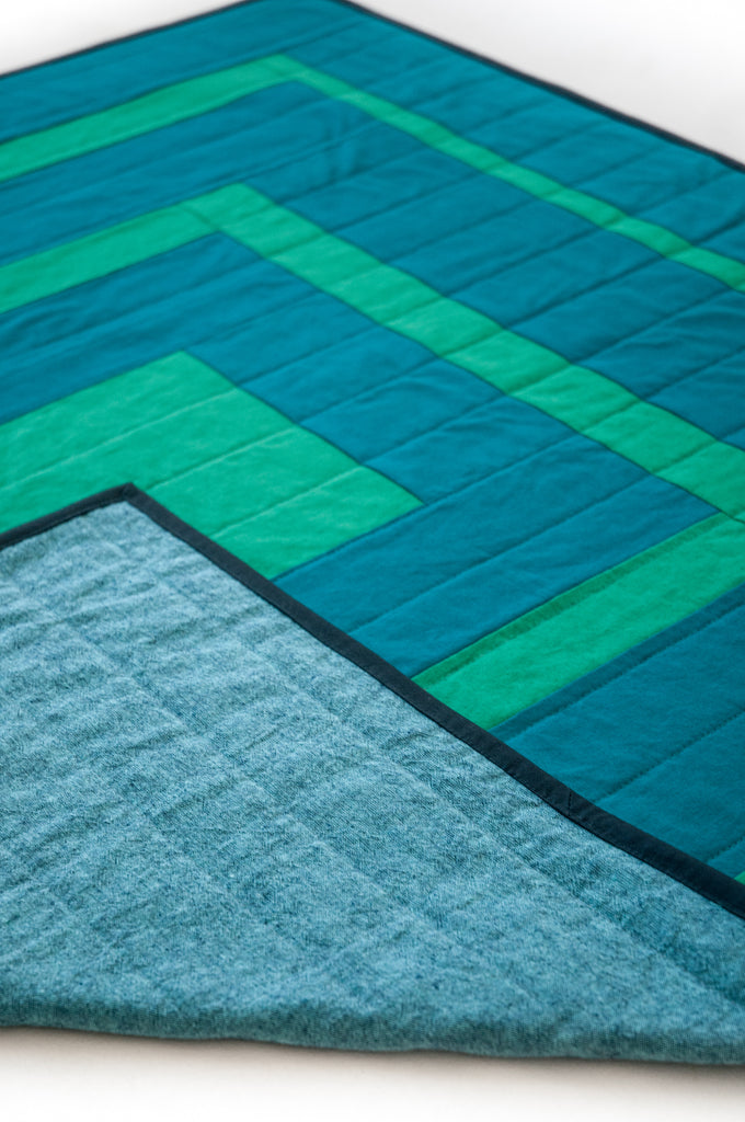 emerald squares quilt with navy binding