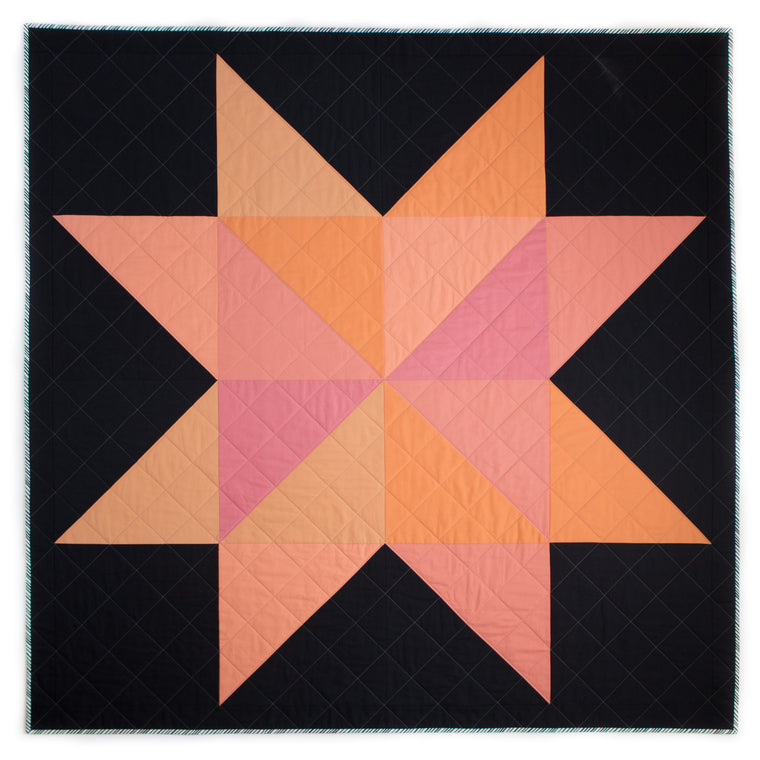 coral sawtooth star quilt