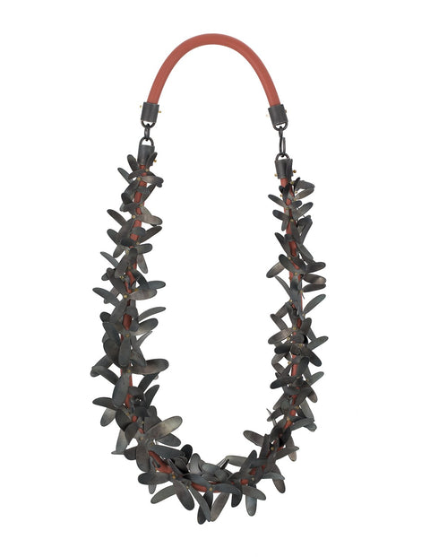 Black steel fringed statement necklace with silicone cording handmade by Maia Leppo
