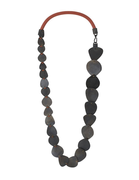 Black oval rhododendron statement necklace with red silicone cording handmade by Maia Leppo