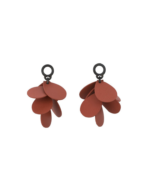 Red silicone petal earrings handmade by Maia Leppo