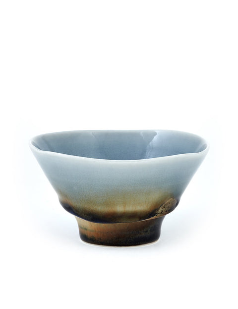 Small high-fired porcelain bowl with pooled cobalt glaze handmade by Noel Bailey.