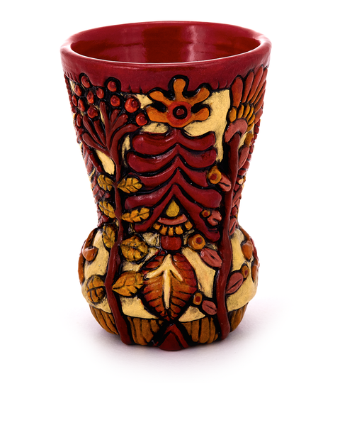 Colorful stoneware tumbler with botanical relief surface handmade by Julie Woodrow.