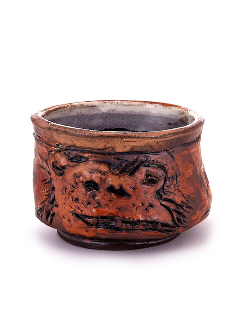 Salt-fired terra cotta teabowl with frog surface relief handmade by Ron Meyers.