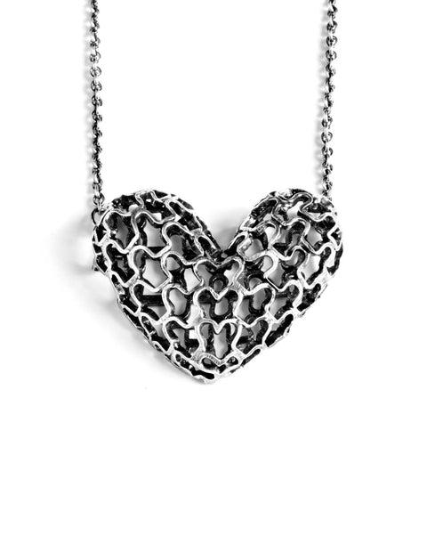 Sterling silver woven heart pendant necklace handmade by Sarah Holden