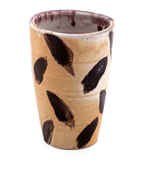 Wheel thrown tumbler with black manganese and wax resisted layered surface design handmade by HP Bloomer.