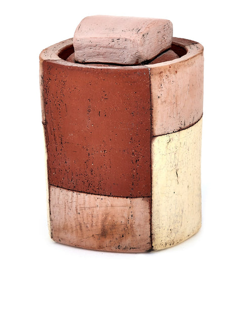 Small terra cotta lidded jar with weathered colorblocked surface handmade by Mark Arnold.