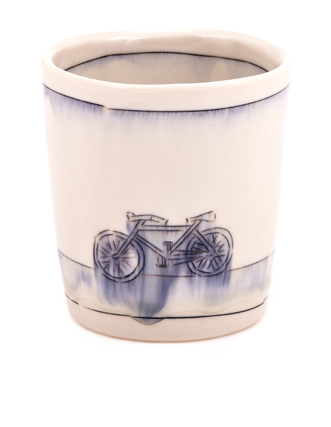 Porcelain whiskey cup with cobalt mishima drawing of a bicycle handmade by artist Nicole Aquillano.