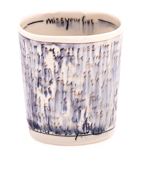 Porcelain whiskey cup with cobalt mishima handwriting handmade by artist Nicole Aquillano.