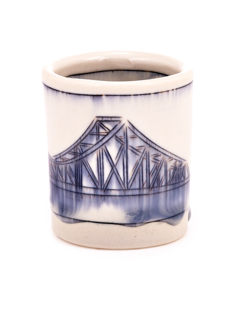 Small porcelain whiskey cup with cobalt mishima drawing of city bridge handmade by artist Nicole Aquillano.