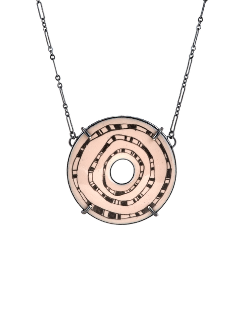Round enameled pendant necklace with graphic pattern handmade by Samantha Skelton.