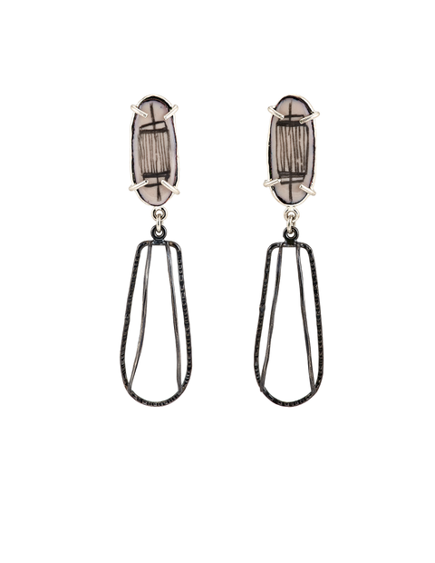White enamel dangle earrings with black design handmade by Samantha Skelton.