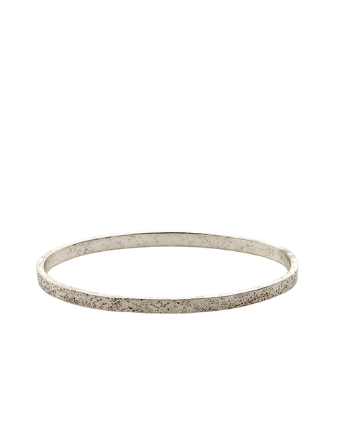 Thin sterling silver bangle bracelet handmade by Samantha Skelton.