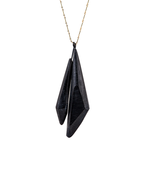 Two black acrylic crystal forms on gold filled wire chain handmade by artist Olivia Shih.