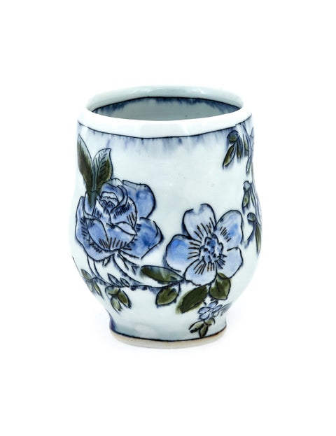 Porcelain mishima teabowl with floral drawings handmade by Katie Susko.