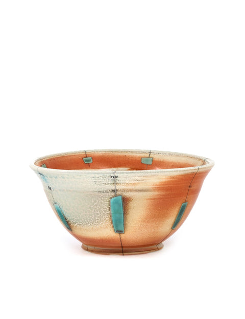 High-fired serving bowl with atmospheric flashing and geometric turquoise glaze handmade by Samantha Hostert.