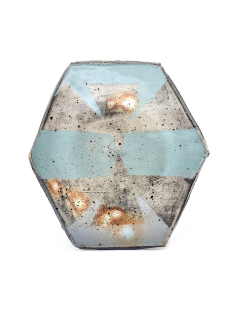 Slab built hexagonal plate with iron oxide stains and geometric slip patterned surface design handmade by Nicholas Danielson.