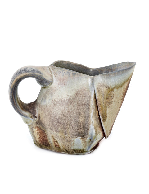 Wood-fired stoneware thrown and altered creamer handmade by Ian Conners.