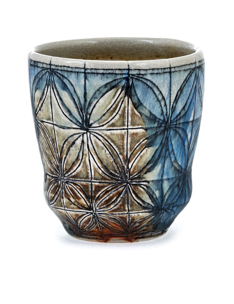 Small high-fired cup with atmospheric flashing and geometric inlay handmade by Samantha Hostert.