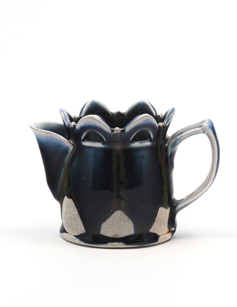 Soda-fired creamer with rich cobalt glaze and pierced rim handmade by Nolan Baumgartner.