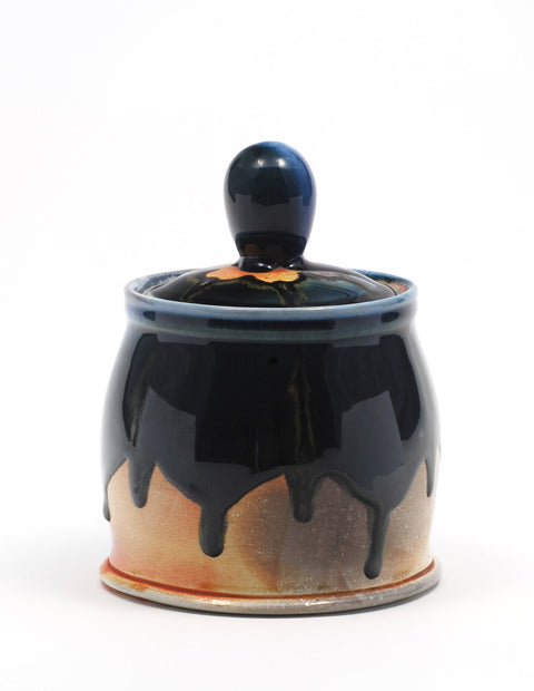 Soda-fired lidded jar with rich cobalt glaze handmade by Nolan Baumgartner.