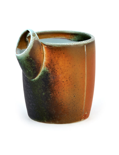 Small soda-fired porcelain pouring vessel with atmospheric flashing