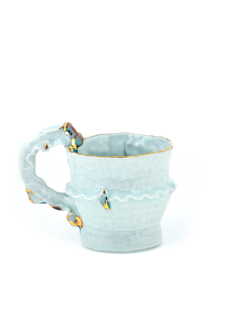 Pinched porcelain orcelain mug with celadon glaze and gold lustre accents handmade by Yoonjee Kwak