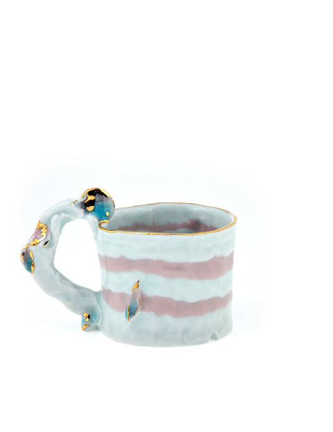Small porcelain espresso mug with pink colored clay and gold lustre accents handmade by Yoonjee Kwak