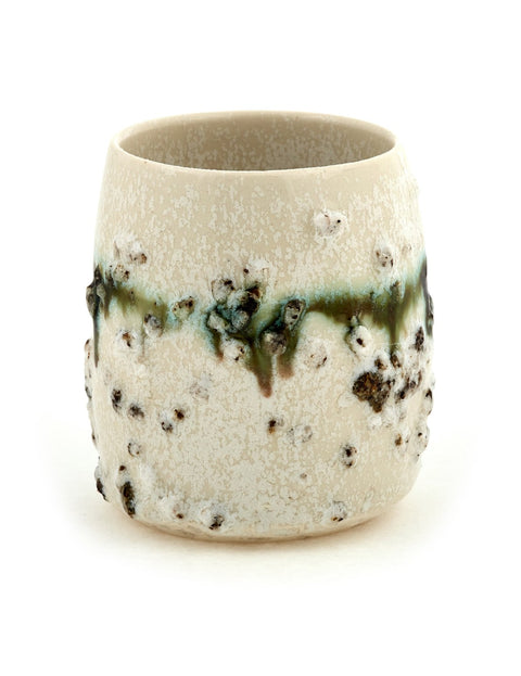 Porcelain cup with textured surface handmade by Erica Iman