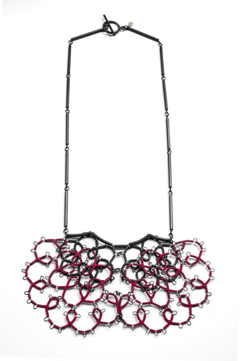 Steel Lace Necklace with red flocking on steel chain, handmade by Sarah Holden