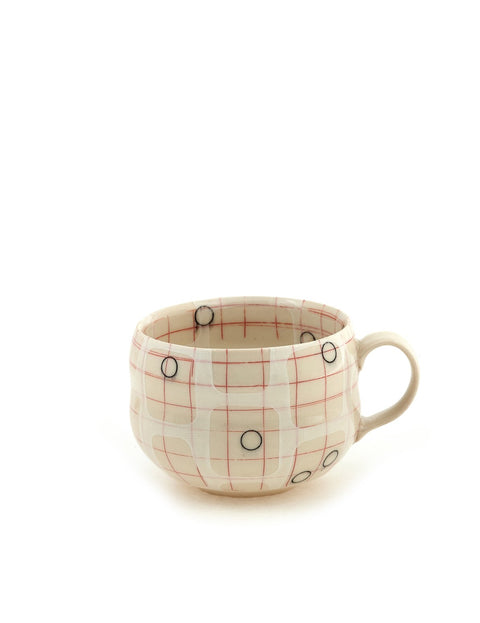 Mid-range porcelain mug with layers of geometric surface design handmade by Rachel Donner.
