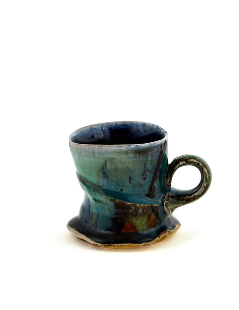 Small wheel thrown mug with organic surface design and glaze handmade by Josh DeWeese.