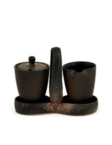 Soda-fired stoneware cream and sugar set with atmospheric flashing handmade by artist Stuart Gair.