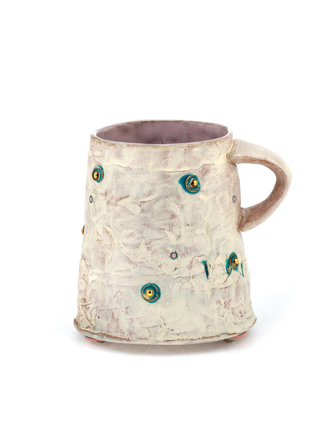White-washed red stoneware mug with gold and copper dots handmade by Didem Mert